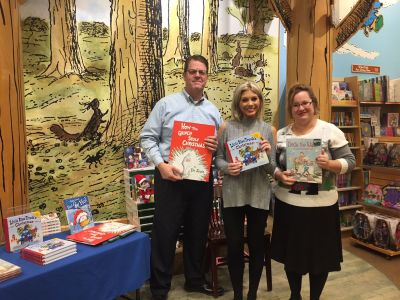KFSM News anchors Daren Bobb and April Walker with Springdale Public Library's Children's Librarian Erin Renollet, who were among the guest readers for our Fayetteville, AR, store's holiday Storytime.