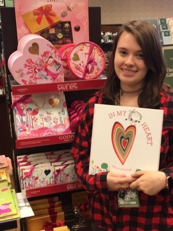 Natalie Burton from our Birmingham, AL, store with one of the store's suggested book donations, In My Heart.