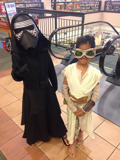 A young Kylo and his enemy Rey pose for the camera in the Buford, GA, store during our Get Pop-Cultured Star Wars event.